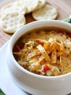 Slow-Cooker Chicken Tortilla Soup! I am going to have to make this soon! Time to buy a Thermos and begin stocking up on soup for winter :)!