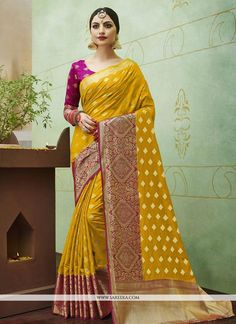 Make the heads flip as soon as you costume up in this sort of a appealing mustard banarasi silk designer traditional saree. The weaving work personifies the overall look. Comes with matching blouse. Elegance Boutique, Stylish Sarees, Saree Look, Soft Silk Sarees, Traditional Sarees, Traditional Outfits, Elegant Saree, Fancy Sarees, Banarasi Sarees