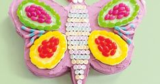 Create an impressive birthday masterpiece like a professional with this colourful butterfly cake.