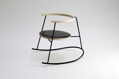 Rocking chair in steel tube and ash wood.