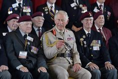 Prince Charles, Prince of Wales, Colonel-in-Chief, Army Air Corps, poses for a group photograph with D-day veterans at a community centre during the D Day 70 Commemoration on June 5, 2014