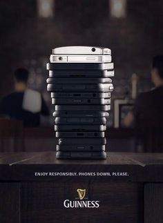 #Guinness is campaigning against the usage of #smartphones in a bar. Just put your phones down and #bottomsup! And how to illustrate this any ...