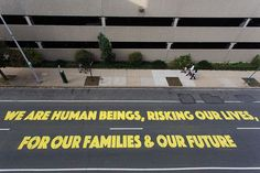 """This piece by @michelleangelaortiz is #3 on our list of the top 10 murals of 2015. """"Familias Separadas/ Somos Seres Humanos (We Are Human Beings)"""" was located outside of the Immigration And Customs Enforcement offices at 1600 Callowhill but it was designed to be temporary and was removed in early November.  Photo by @steveweinik (PS yes we digitally altered this image to remove a red car which you might recall seeing when we last posted this photo) by muralarts"""