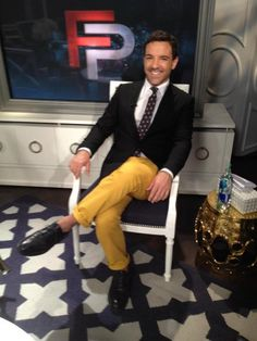 BLAZER: Prada  SHIRT: Theory  TROUSERS: Brooks Brothers  TIE: CHANEL  SHOES: Black Fleece by Brooks Brothers