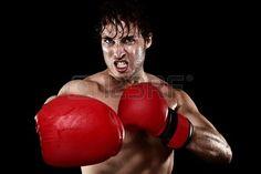 Boxing Boxer Mann mit Boxhandschuhen Schlagen und Stanzen suchen w tend Starke Muskeln fit Fitness M Lizenzfreie Bilder