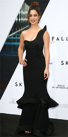 BÉRÉNICE MARLOHE  The newest Bond girl gets decked out for the Germany premiere of Skyfall, wearing a black one-shoulder gown with a tiered skirt and Marina B jewelry.