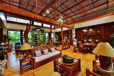 The interiors tell you a creative genius lives here. Now available to visitors. Tropical House Design, Tropical Houses, Filipino Interior Design, Bahay Kubo, Thai House, Bamboo House, Bed And Breakfast, Art And Architecture, Modern Interior