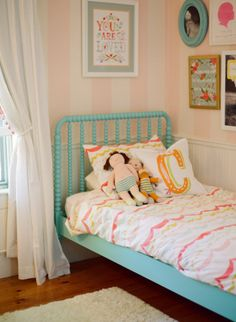 I love those pink striped walls!!