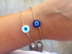 Excited to share this item from my #etsy shop: Gold string evil eye bracelet women Gold evil eye jewelry men Evil eye charm Protection bracelet Adjustable bracelet Good luck gift jewelry #gold #birthday #christmas #evileye #yes #unisexadults #glass #tie #minimalist Evil Eye Jewelry, Evil Eye Bracelet, Gold Bracelet For Women, Bracelets For Men, Greek Evil Eye, Red String Bracelet, Good Luck Gifts, Greek Jewelry, Evil Eye Charm