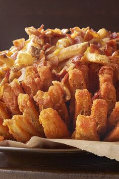 This Is Not a Drill: Outback Is Releasing a Bloomin' Onion Topped With Bacon Cheese Fries