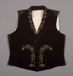 Waistcoat Date: ca. 1856 Media: Velvet And Embroidery Country: France Accession Number: 36476 Raised embroidery of grape clusters. A velvet waistcoat of this design, including the small demi-lune pocket on the upper left, is in the collection of the V & A, dated 1845-1850.
