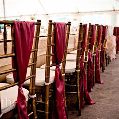 The head table chairs received extra embellishment from a deep burgundy sash tied vertically to the chair backs.....a great idea for those who can't do bows