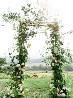 White rose and vine outdoor wedding altar at Pippin Hill Farm & Vineyards | PHOTOG: Luna De Mar | PLANNER - Cody with Amore Events | Video - East West | Ceremony Musicians - Plum Trio | Band - Soul Fusion | Floral - Amy Osaba | Cake - Sweethaus | AV and Lighting - BRAVL | Transpo - Blue Ridge Tours | Rentals - Festive Fare and MS Events