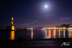 Full moon, lighthouse, old harbour, Chania, Crete, Greece