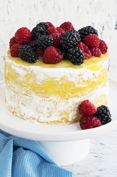 This MOIST LEMON CAKE recipe with lemon curd and seven minute frosting is perfect for Summer. This naked lemon layer cake is made from scratch and bursting with zesty lemon flavors. From cakewhiz.com