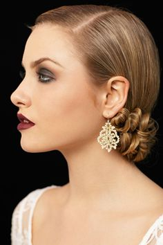 A heavy smoky eye and wine coloured lip against flawless, matte skin complete this dramatic look