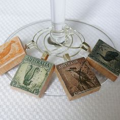 DIY your photo charms, compatible with Pandora bracelets. Make your gifts special. Make your life special! Postage Stamps Wine Charm, Australia 1937 (or pendants! This site has lots of wonderful postage stamp art projects. Postage Stamp Art, Wine Glass Charms, Vintage Stamps, Photo Charms, Stamped Jewelry, Resin Jewelry, Bijoux Diy, Mail Art, Stamp Collecting