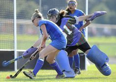 9/14/2012 Mike Orazzi | Staff  Southington goalie Susie Marcoux (61) and Glastonbury's Courtney Peterson (14) during field hockey action at Southington High School on Friday.