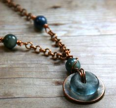 African Glass Bead on Copper Washer with Wire Wrapped Beads ~ Necklace by AllowingArtDesigns on Etsy https://www.etsy.com/listing/213268579/african-glass-bead-on-copper-washer-with