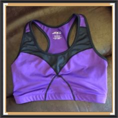 BCG New Purple and Black Sports Bra I got this it says it is a large I'm 36 C and it's too snug it flattens me out too much. Definately more for a 34B or 36 B cup. It is in new condition. I really love this brand they have a lot of great clothes with pretty colors and are very good quality or at least that has been my experience so far. BCG Intimates & Sleepwear Bras