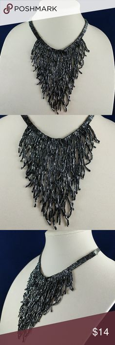 Tie Back Beaded Statement Necklace NWT Beautiful beaded necklace is adjustable with tie back ribbon. Color is a shiny blue grey. Brand new with tag. L21 Macy's Jewelry Necklaces