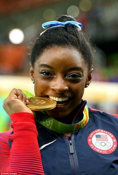 Gold medalist Simone Biles of the United States poses after the medal ceremony for the Women's Individual All Around in Rio