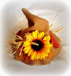 Scarecrow Hat: I should add a sunflower and straw to my hat.