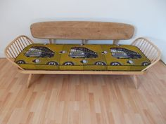 This unique and completely bespoke piece was created by us here at the Bees Knees Furniture :-) We teamed the iconic Ercol Day Bed with this fabulous retro print. I f you would like us to source or create something completely unique for your home, drop us a line: infor@beeskneesfurniture.co.uk