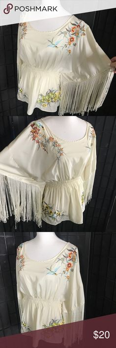 Stunning ivory embroidered fringe top Stunning fringe embroidered top  size medium This gorgeous top is so pretty and made well with beautiful embroidery to show off with a gorgeous necklace. Tops Blouses