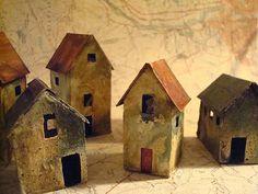 Miniature abandoned house sculptures