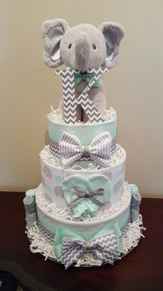 Mint green and gray elephant diaper cake. Baby Shower Center Piec… - Baby Diy - Mint green and gray elephant diaper cake. Baby shower center piece … Mint green and gray elephant - Baby Cakes, Baby Shower Cakes, Baby Shower Diapers, Baby Shower Fun, Baby Shower Themes, Baby Shower Gifts, Baby Gifts, Shower Ideas, Diaper Shower
