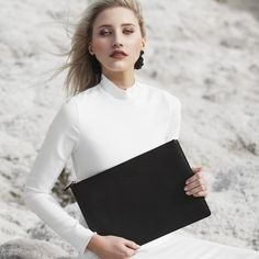 Cindy clutch - The perfect companion to take you from day to night. The Cindy clutch has you covered with inner zip pocket and built in card slots. Cindy also doubles as a stylish iPad case or the perfect travel bag. Available in black Brisbane, Perth, Melbourne, Sydney, Hobart Australia, Cairns, Travel Bag, Ipad Case, Leather Handbags