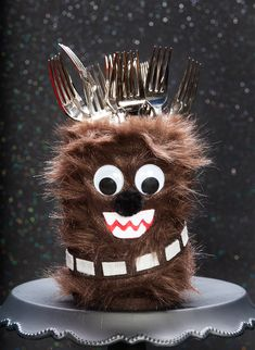 """Thanks to HP® for sponsoring this article. This easy-to-make Chewbacca Utensil Holder will take your next Star Wars party from galactic to """"Gawrgargawrgaaaaa."""""""