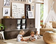 WHY THIS ROOM WORKS A neutral color palette makes it easy to incorporate this play area into a larger family space. Toys, games and books remain organized and out of sight with the help of a versatile storage system. Natural elements—like the woven accent table, indoor plant and jute rug—add to the easygoing vibe. A teepee offers a fun hideaway, while black-and-white wall art is both playful and sophisticated.