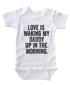 "- These ""Love is Waking My Daddy Up in the Morning"" Onesies will sure to make all daddys very happy. Perfect for baby shower and father day gift. - Color: White/Black/Pink/Blue - Material: 100% Cotton"
