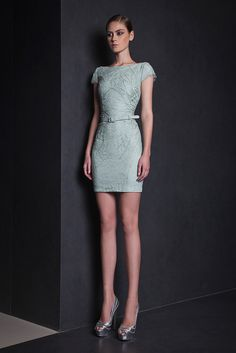 Lace Watergreen short dress with boat neckline and cap sleeves, embellished with Silk thread embroideries.