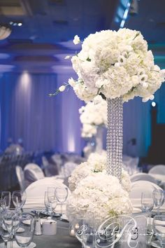 White floral centrepieces on crystal tower stands Photo credit @Terry Song Song Goldfarb Digital