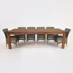 Enna side chairs are included in a set with The Manhattan, a 4-legged table made from reclaimed teak.