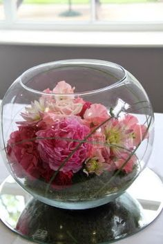 fishbowl floral mirror plate centrepiece.  Follow us for more planning inspiration or contact us at www.tidesevents.co.uk for help planning your party.