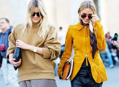 This duo make neutrals look so good. A suede yellow zipped jacket and tan sweatshirt with gold accessories.  // Photo: The Styleograph #Streetstyle #PFW