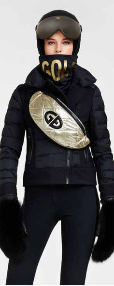 Black and gold ski wear and luxury accessories for skiing including ski helmets, pompom fur hats, scarves, bags, backpacks, gloves and mittens. Black Ski Jacket, Ski Jackets, Jackets For Women, Ski Helmets, Leopard Print Pants, Ski Holidays, Ski Wear, Ski Fashion, Sports Luxe