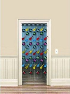 """Rock-N-Roll Doorway Curtain 72in by Amscan, Inc.. $6.19. Kids' Party Supplies. Rock N Roll. Step into the malt shop through our Rock and Roll Doorway Curtain. This curtain measures 78"""" in length and can be easily cut to fit whatever length you require. Includes plastic strands with records and guitar cutouts attached to them.. Save 19% Off!"""
