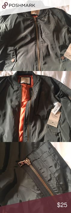 NWT Olive Green Bomber Jacket 💚 Brand NWT Bomber Jacket 💚 Deep Dark olive green with Orange Lining. Gold toned zipper and hardwood. Size Large. Never before worn. Looks great with jeans, leggings. Warm, Cozy, stylish all in one. ❌ NO TRADES❌ Please ask me anything or make me an offer! Xoxo Jackets & Coats
