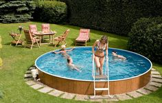 Above Ground Swimming Pools For Small Yards With Teak Wood Folding Chairs And Round Table Sets Swimming Pool Designs for Small Yards Above Ground Pool Landscaping, Backyard Pool Landscaping, Small Backyard Pools, Swimming Pools Backyard, Outdoor Pool, Backyard Ideas, Small Backyards, Swimming Pool Kits, Natural Swimming Ponds