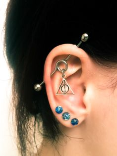 Deathly hallows industrial barbell surgical stainless steel 14g/1.6mm https://www.etsy.com/uk/listing/267471004/deathly-hallows-industrial-barbell-harry
