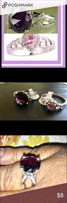 2 Topaz Rings for the Price of 1! Size 11 NWT Two beautiful rings are available for just one price! One is a Pink Topaz heart ring in silver base. Stone is 5 mm x 5mm in size. Other is a Round Cut Amethyst & White Topaz Purple Gemstone ring with a silver base. Stone is 12 mm x 12 mm in size. Jewelry Rings