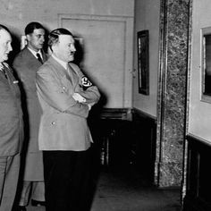 Hermann Goering and Adolf Hitler tour the artworks at the Degenerate Art exhibit. The Nazis staged the exhibition in a propaganda drive to demonstrate the moral and cultural decadence of Jewish and modernist artists