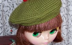 My first hat design for Blythe--a crocheted tam for Fiona, my Blythe! This tam is crocheted amigurumi-style (in a spiral) so it has no jo...