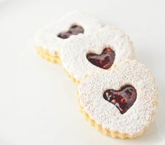 Linzer Cookies -- Enjoy these delicious cookies with Polaner Red Raspberry Preserves - Eat well and be well with Polaner products. polanerallfruit.com #preserves #raspberry #cookies