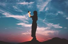 A silhouette woman holding lights stands in front of a blue and red twilight sky backdrop Reiki, Twilight Sky, Relationship Bases, Relationship Advice, Relationships, Free Desktop Wallpaper, Wallpapers, Les Religions, Spiritual Healer